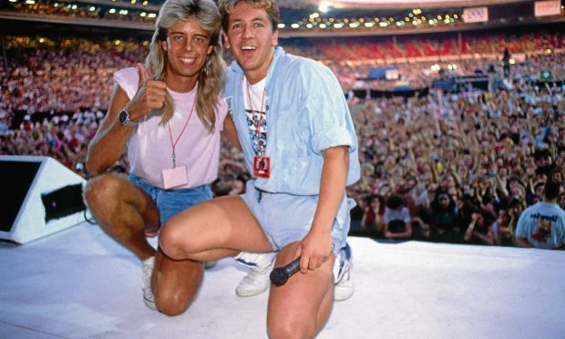 Curly and shorts. THAT photograph of me, with DJ Pat Sharp as I introduced Bros