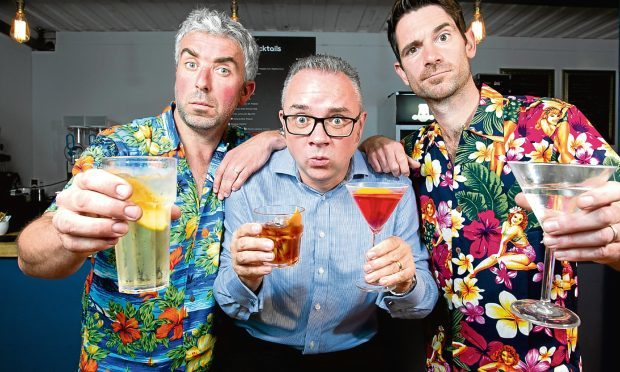 """Our reporter Alan Shaw (centre) sampling various drinks and cocktails served up by the """"Thinking Drinkers"""", Ben McFarland and Tom Sandham (Andrew Cawley / DC Thomson)"""