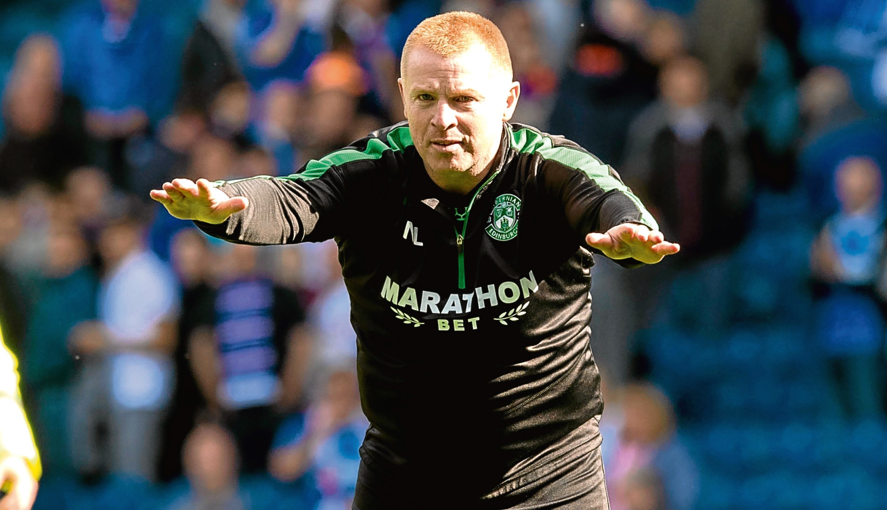 Hibernian head coach Neil Lennon celebrates at full time after the win over Rangers (SNS Group)