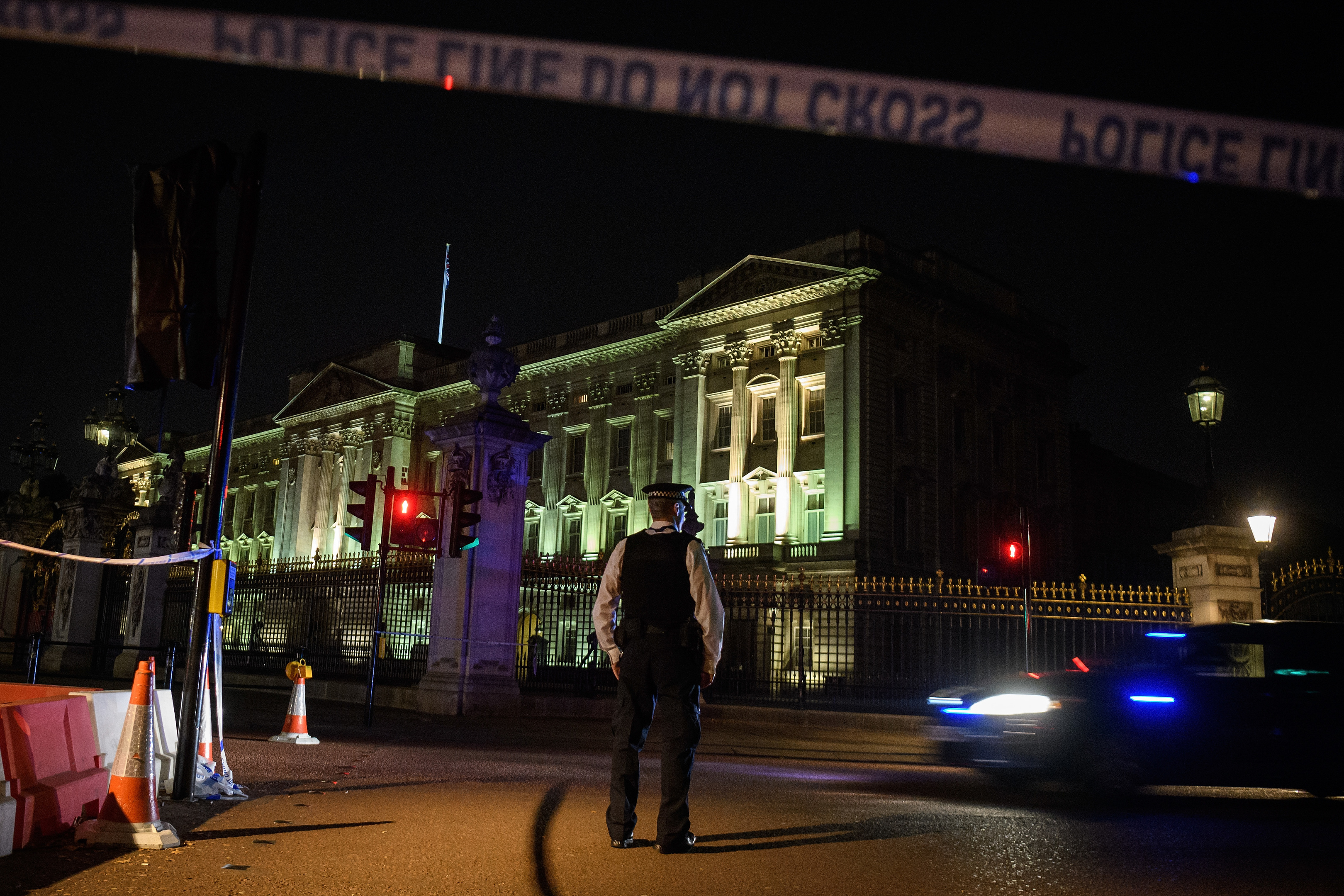 Police teams secure the roads behind a cordoned area following an attack on two police officers at Buckingham Palace (Leon Neal/Getty Images)
