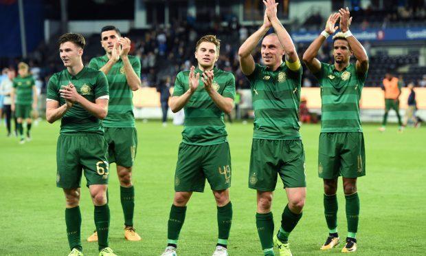 Celtic's Kieran Tierney, James Forrest, Scott Brown and Scott Sinclair (L-R) applaud the fans at full time (SNS Group / Craig Williamson)