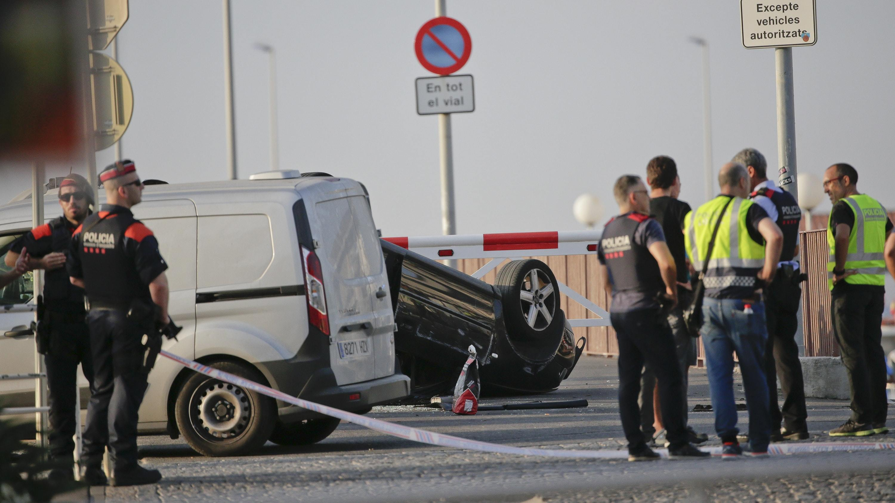An overturned car at the spot where terrorists were intercepted by police in Cambrils, Spain (Emilio Morenatti/AP)