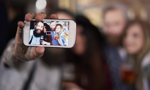 Social media users take an average of six selfies before selecting the best one to upload (iStock)