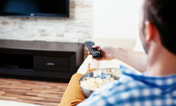 Catch-up technology such as BBC iPlayer, and subscription services including Netflix, meant 79% of viewers watch multiple episodes of their favourite pre-recorded shows - despite one-third (32%) of adults saying it resulted in them missing sleep (iStock)