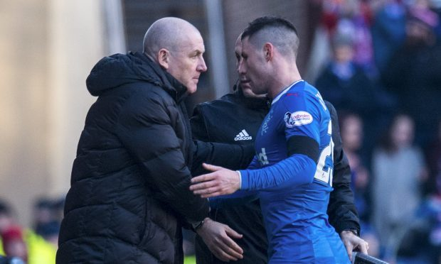 Rangers manager Mark Warburton (left) with Michael O'Halloran (PA)
