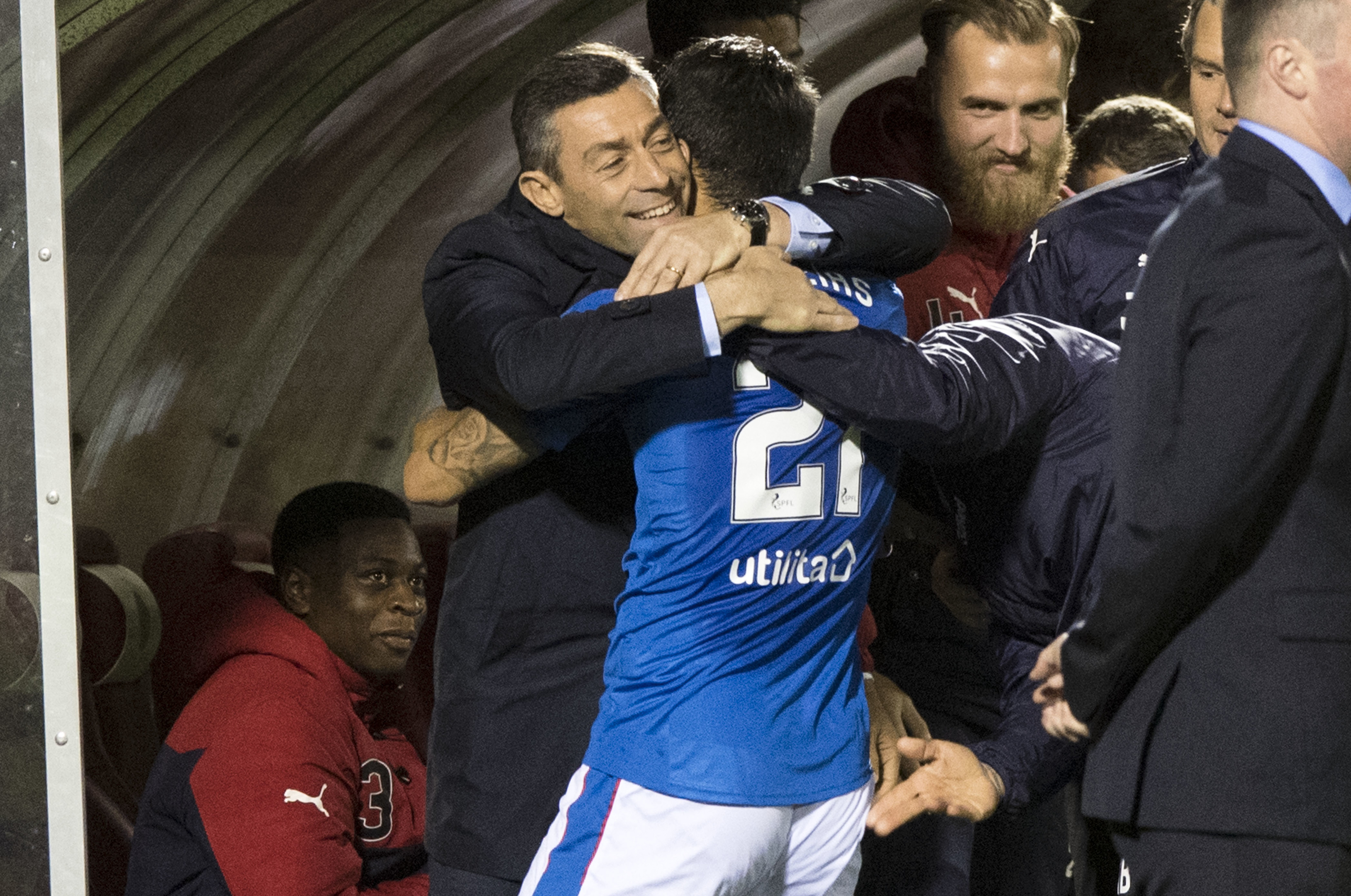 Rangers manager Pedro Caixinha (left) celebrates with Daniel Candeias after scoring his side's third goal (SNS)