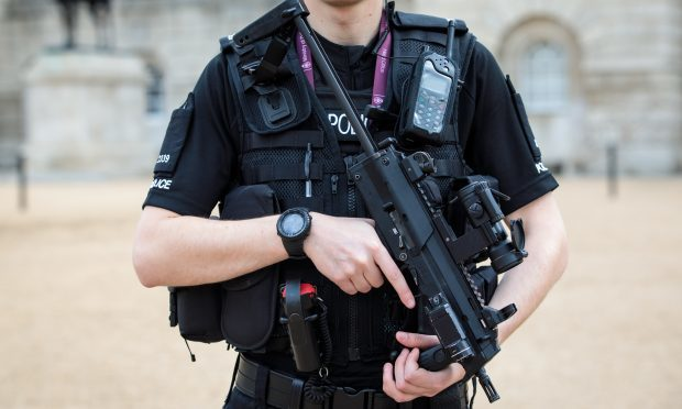 An armed police officer (Jack Taylor/Getty Images)