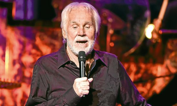 "Kenny Rogers performs onstage during his final world tour ""The Gambler's Last Deal"" (Kevin Winter/Getty Images)"