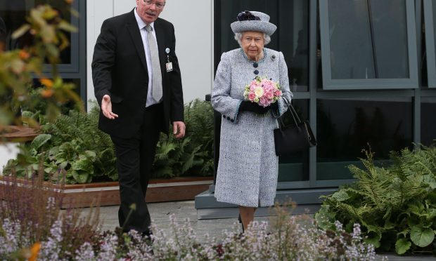 Queen Elizabeth II with NHS Grampian Reverend James Falconer, Healthcare Chaplain and project lead for the Robertson Family Roof Garden, during a visit to Aberdeen Royal Infirmary to open the roof garden and meet patients and staff. (Andrew Milligan/PA Wire)