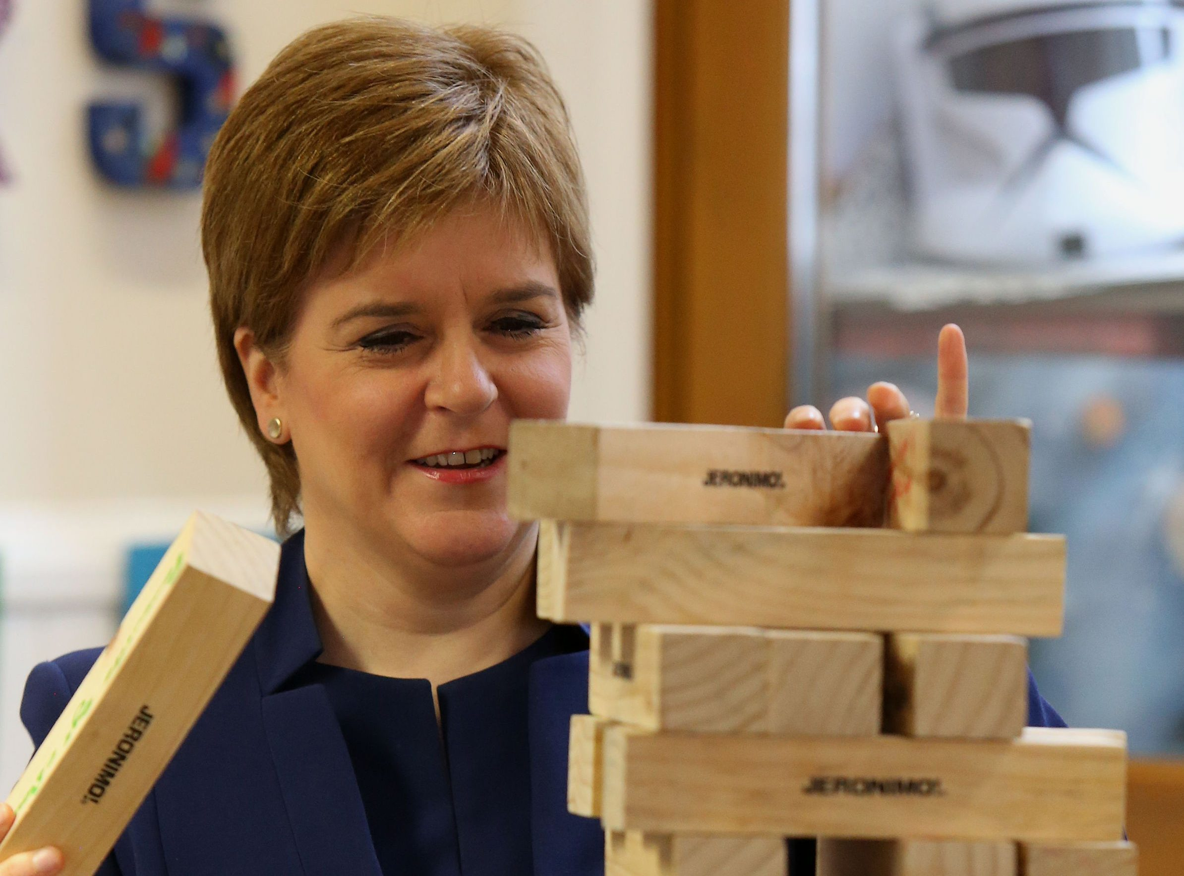 First Minister Nicola Sturgeon playing jenga at the launch of a new young carers grant at Edinburgh Young Carers Project. (Gordon Terris/The Herald/PA Wire)