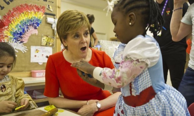 First Minister Nicola Sturgeon meets some of the children (name not given) at the Butterfly Nursery in Arden, Glasgow, who are among the first recipients of the doubling of free childcare. (John Gunion/The Scottish Sun/PA Wire)