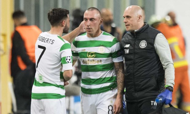 Celtic's Scott Brown (right) is replaced after suffering an injury (SNS Group)