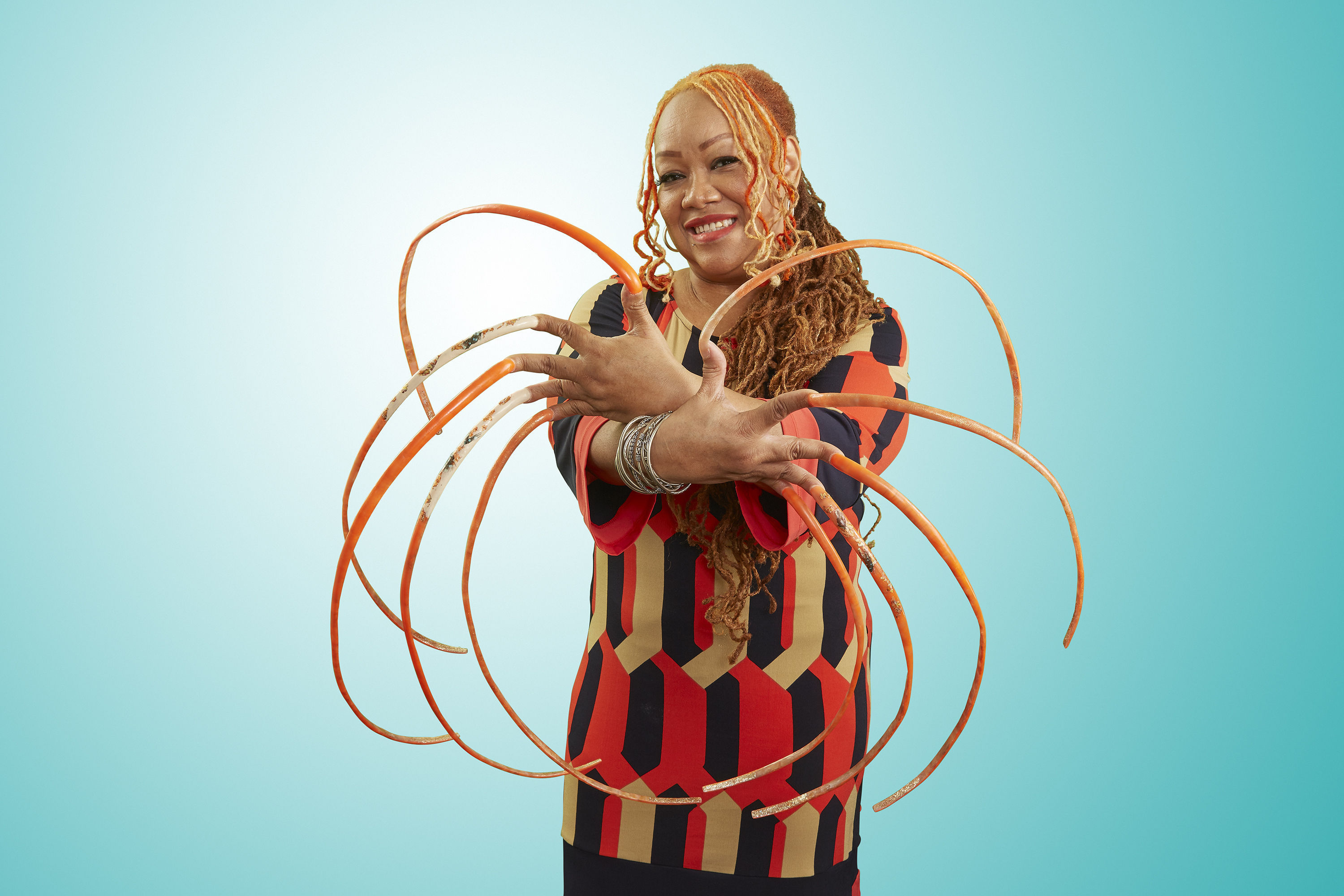 Nail artist grows world's longest fingernails