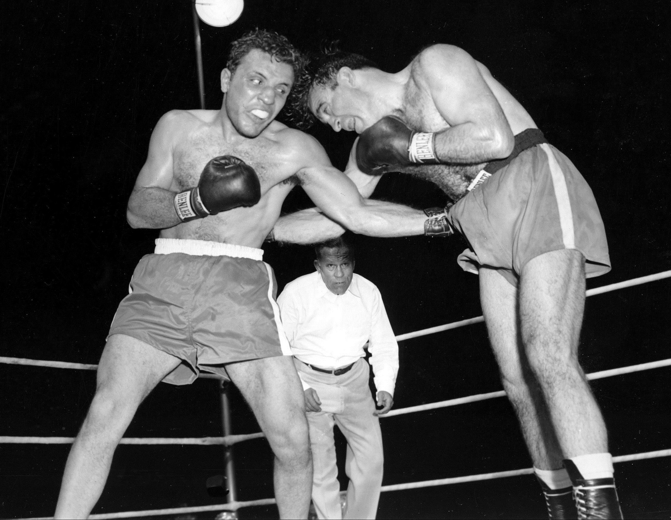 Jake LaMotta, left, pounds Marcel Cerdan in third round of a world middleweight title bout in 1949 (AP Photo/File)