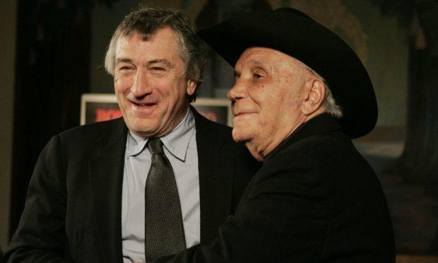 Robert DeNiro, left, meets boxer Jake LaMotta in 2005 (AP Photo/Julie Jacobson, File)