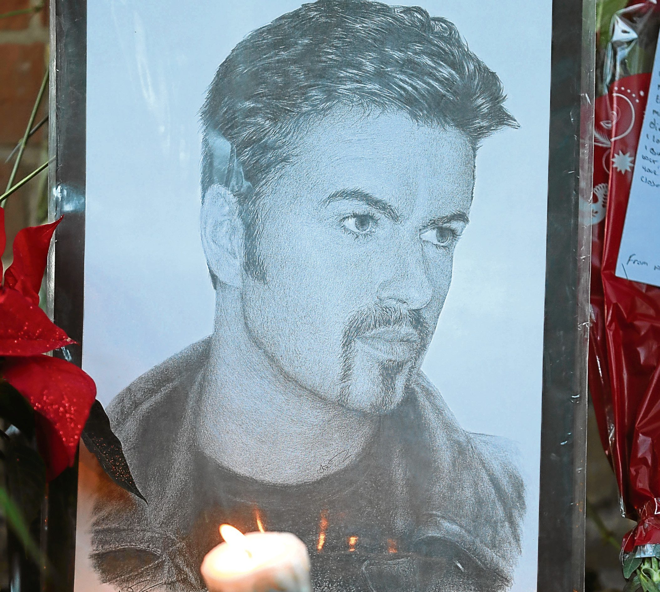 Tributes outside the Goring house of George Michael (Andrew Matthews/PA Wire)