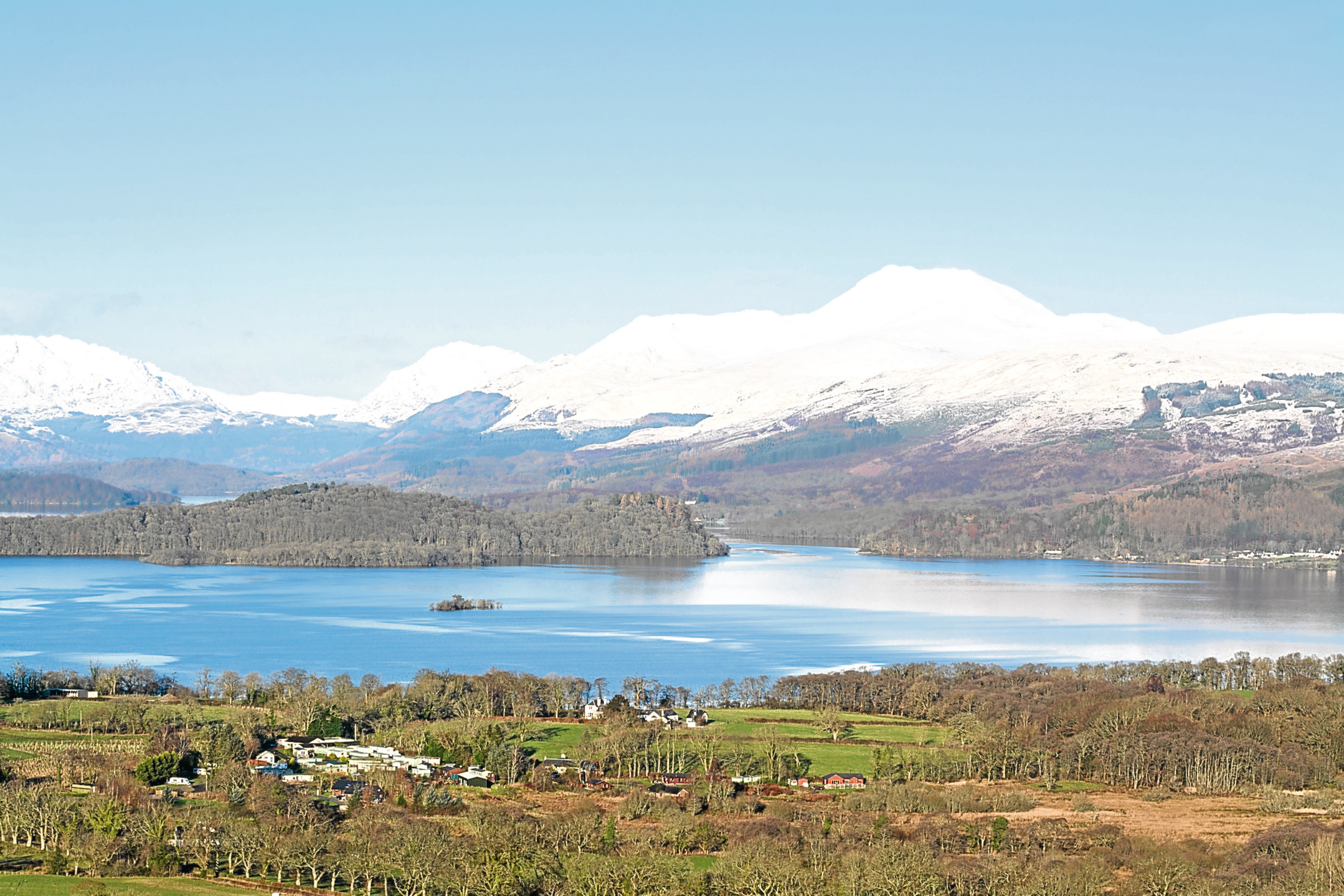 Snow covered Ben Lomond overlooking Loch Lomond, Scotland.