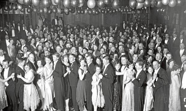 Guests dancing in the ballroom aboard Cunard liner 'Berengaria' at Southampton Docks. They are attending a dance and cabaret to raise funds for charity. (Puttnam/Getty Images)