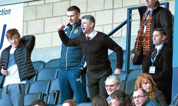 Motherwell manager Stephen Robinson celebrates in the stands. (SNS)