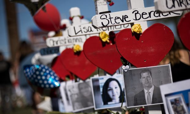 Photographs of the victims are included on some of the 58 white crosses for the victims of last Sunday night's mass shooting (Drew Angerer/Getty Images)