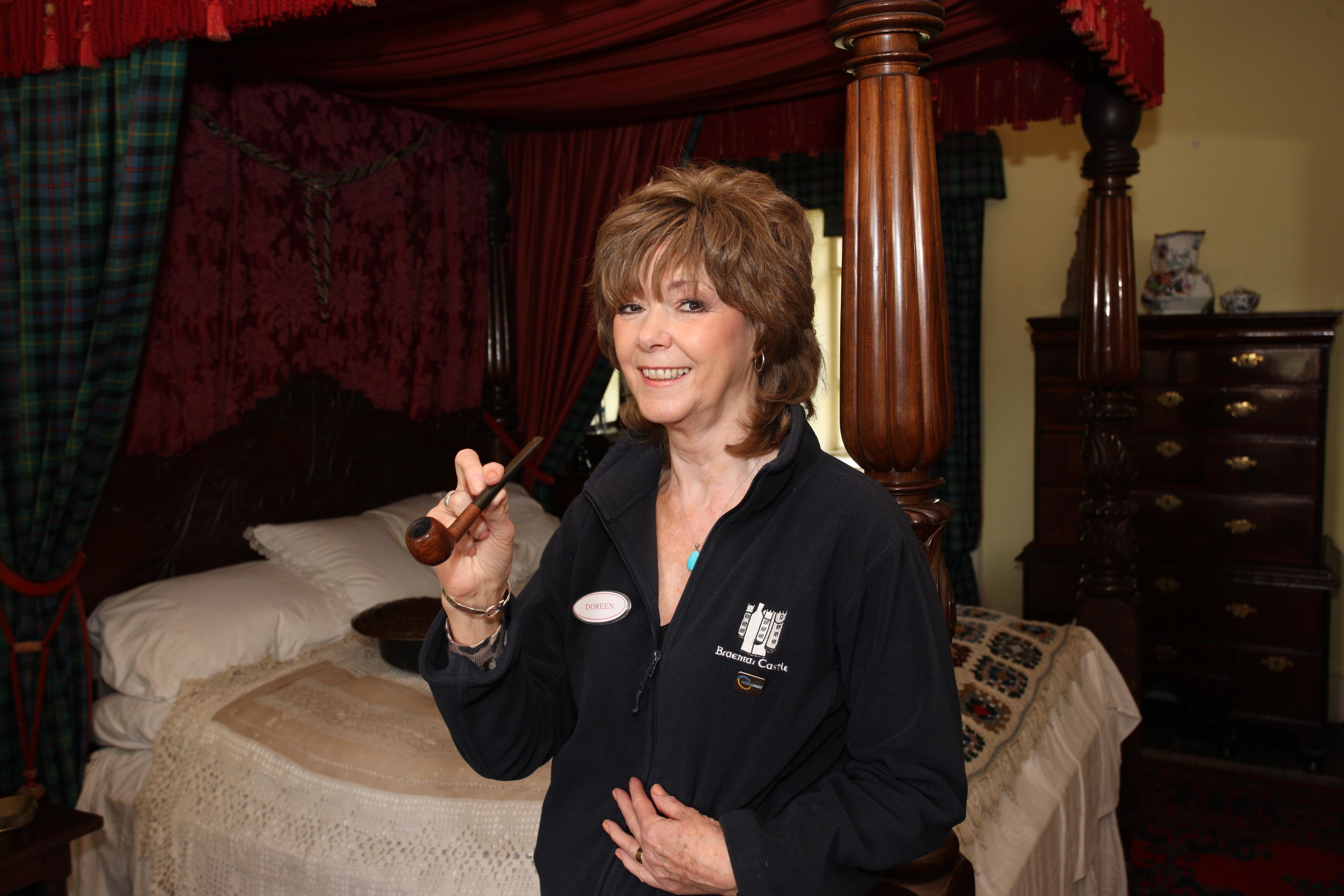 Doreen Wood with the 4 poster bed at Braemar Castle which is haunted by the ghost of the Black Colonel, there is also the smell of pipe smoke (Peter Jolly)