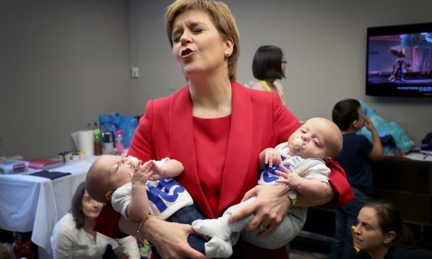 First Minister Nicola Sturgeon with 13-week-old twins Catherine (left) and Sam Shepherd, from Kirkintilloch, in the creche at the Scottish National Party conference at the SEC Centre in Glasgow. (PA)