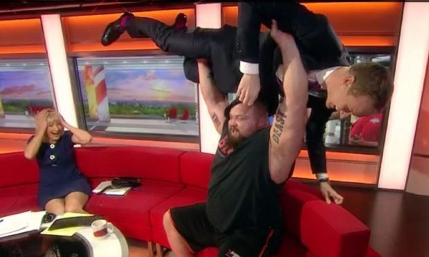 BBC Breakfast's Dan Walker bench pressed during live broadcast (BBC/screengrab)
