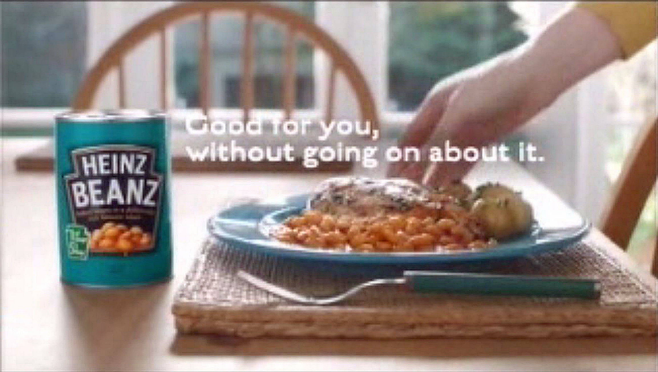 """The television ad, seen in May, showed a man arriving home to his family and taking a drink from the fridge which he described as having protein """"supercharged with high fibre and minimal fat"""", before his wife said: """"Same. We're just having some beans."""" (ASA/PA Wire)"""