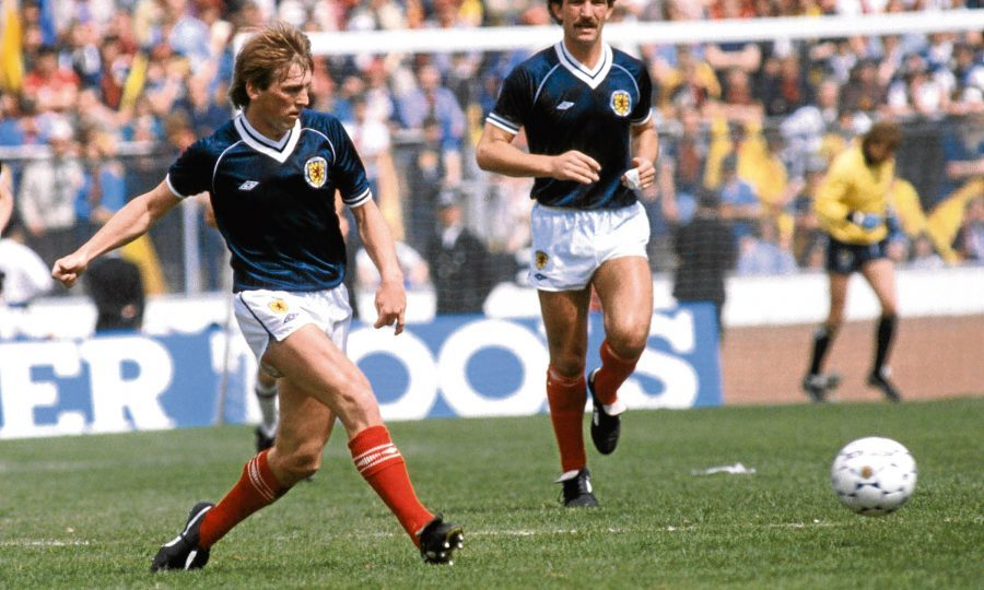 Scotland's Kenny Dalglish (left) passes the ball watched by Graeme Souness