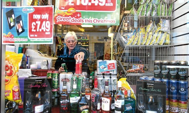A woman in an off-licence in Govan, Glasgow (Getty Images)