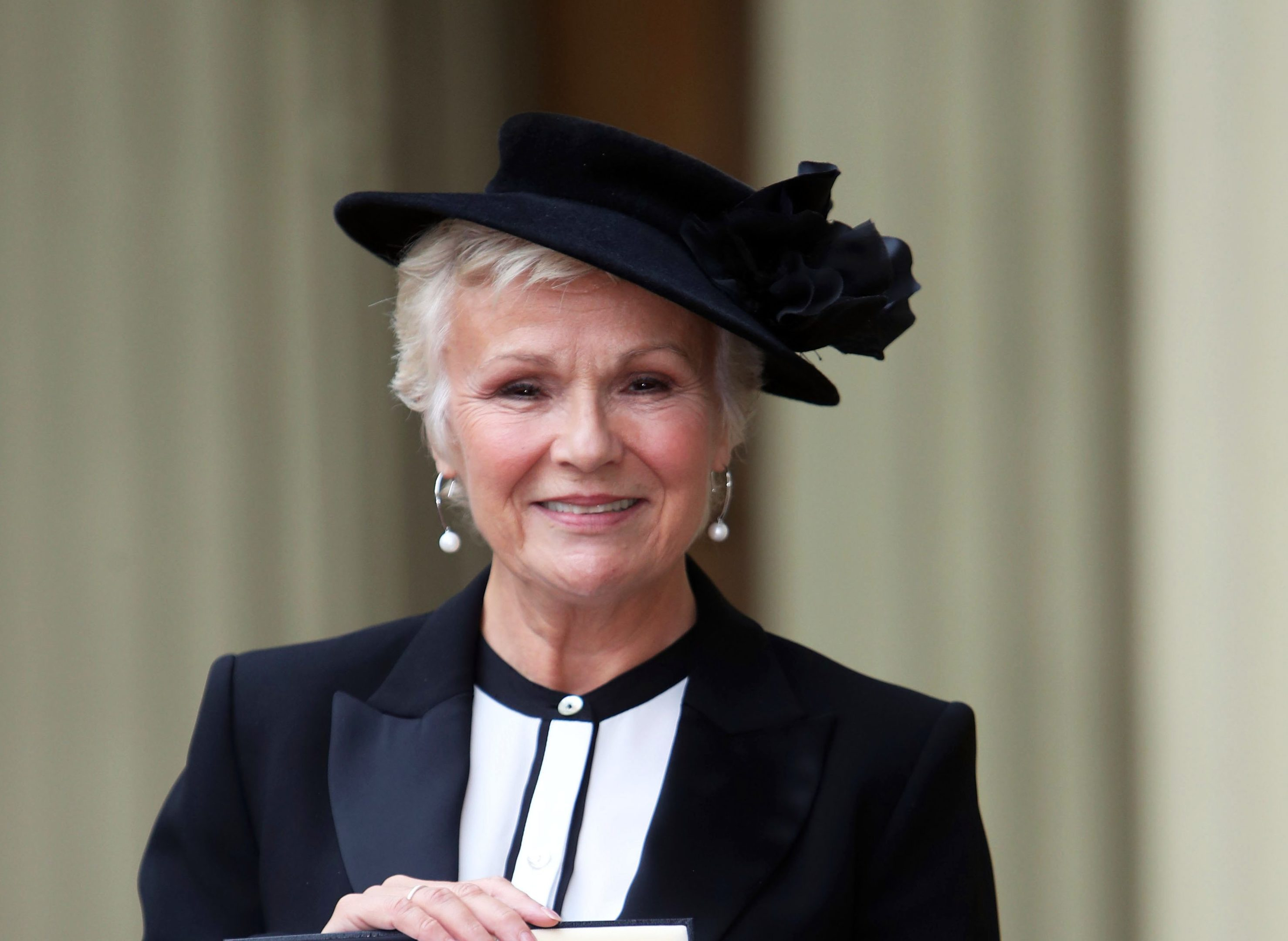 Dame Julie Walters poses after she was awarded a Damehood by Queen Elizabeth II (Steve Parsons - WPA Pool/Getty Images)