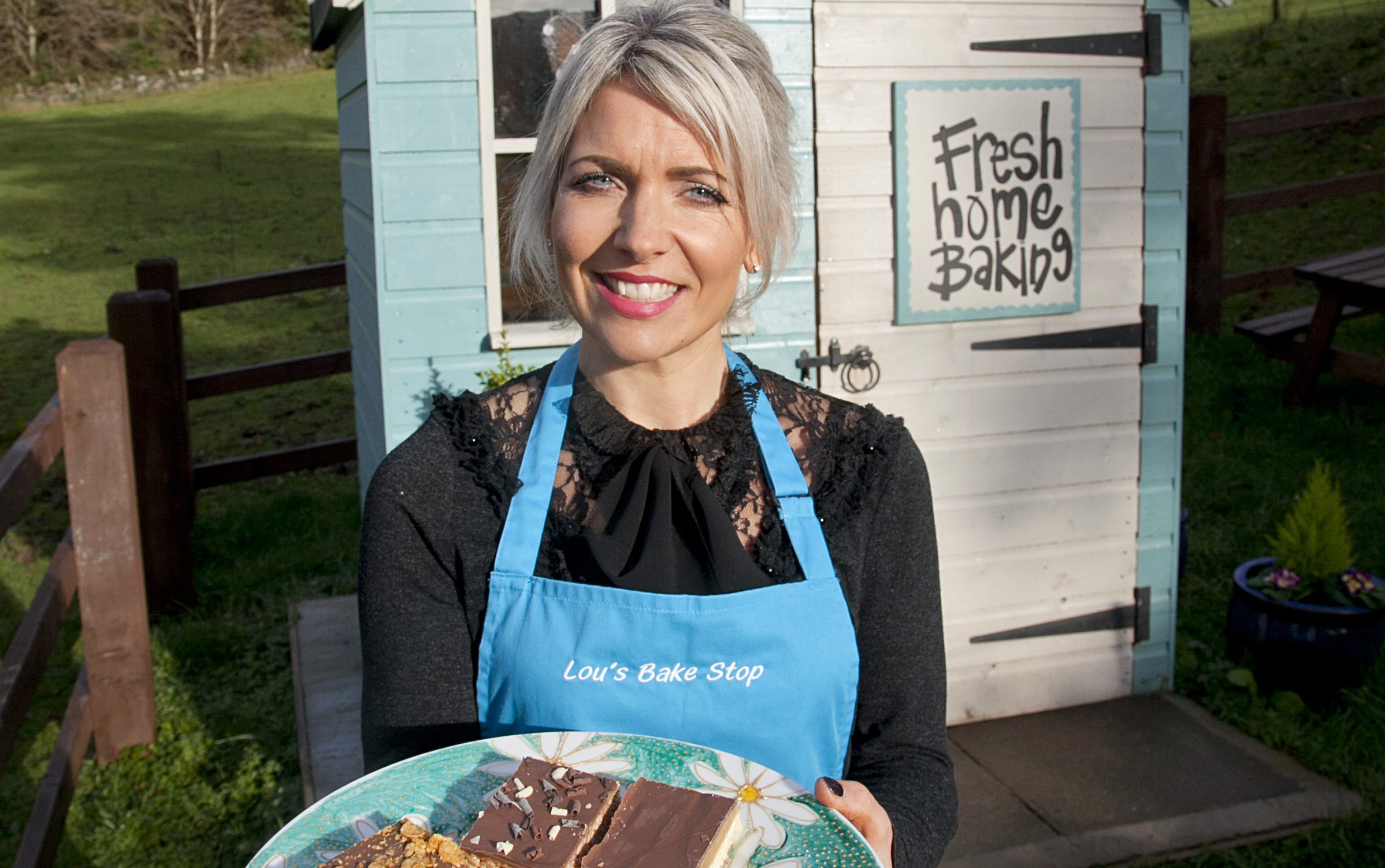Louise Paterson at her cake hut with an honesty box, just outside Balfron (Alistair Linford)