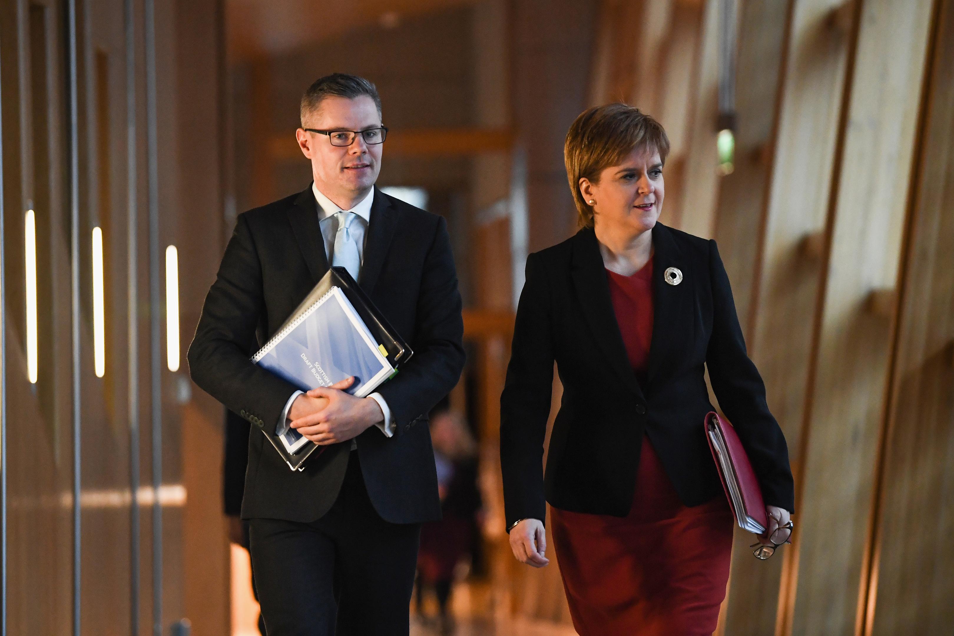 Finance Secretary Derek Mackay and Scotland's First Minister Nicola Sturgeon  (Jeff J Mitchell/Getty Images)