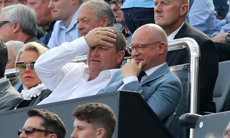 Mike Ashley (left) and Lee Charnley in the stands during A Premier League (PA)