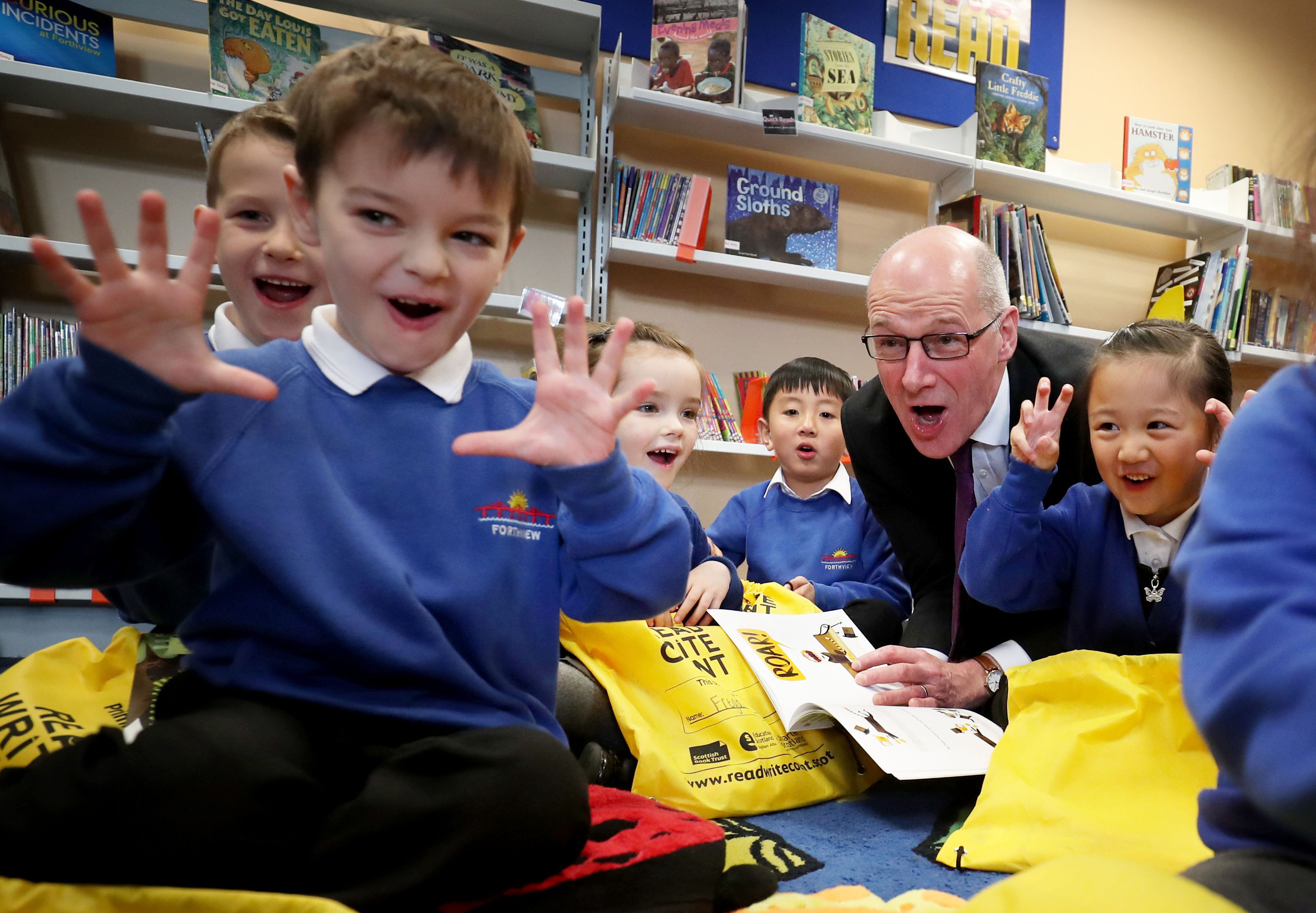John Swinney, pictured on a visit to an Edinburgh primary school, is under pressure on class sizes (Jane Barlow/PA Wire)