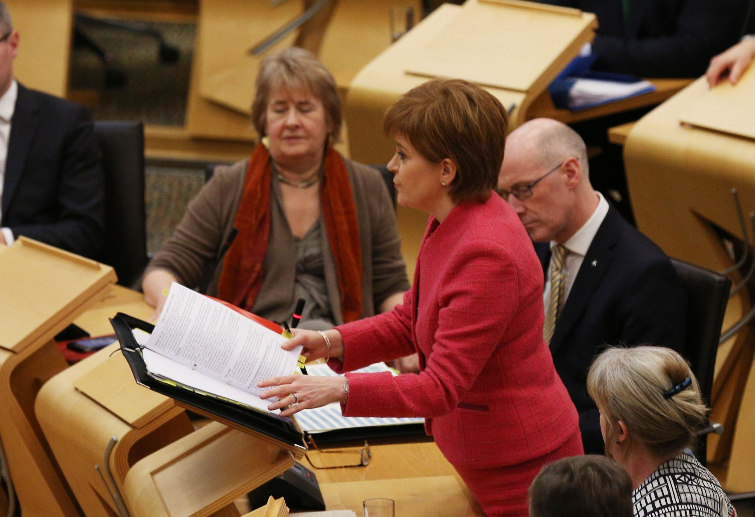 First Minister Nicola Sturgeon in the debating chamber during FMQs at the Scottish Parliament in Edinburgh (David Cheskin/PA Wire)