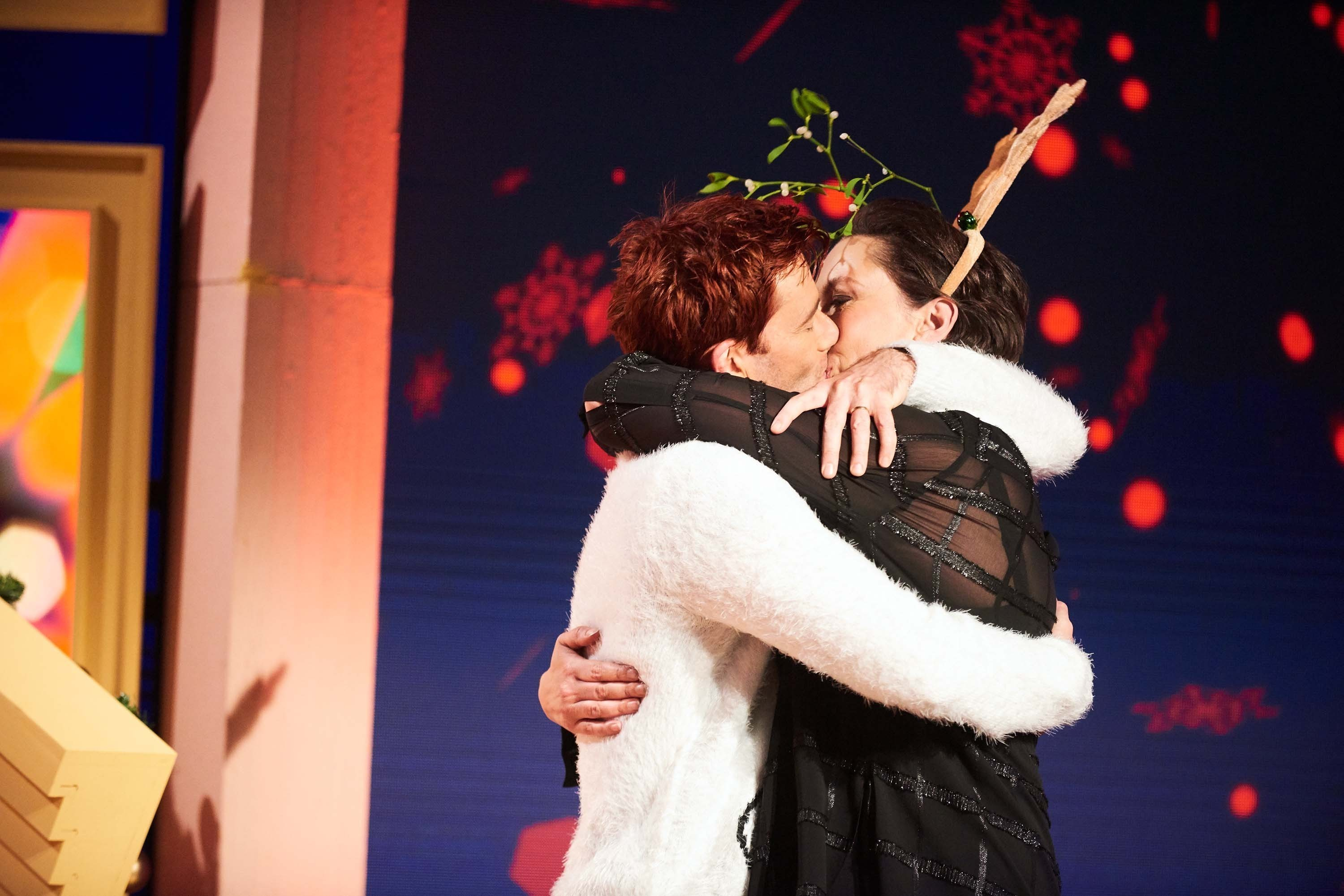 David Tennant kissing Miranda Hart as she presents her Christmas programme Miranda Does Christmas. (Ray Burmiston/Channel 4/PA Wire)