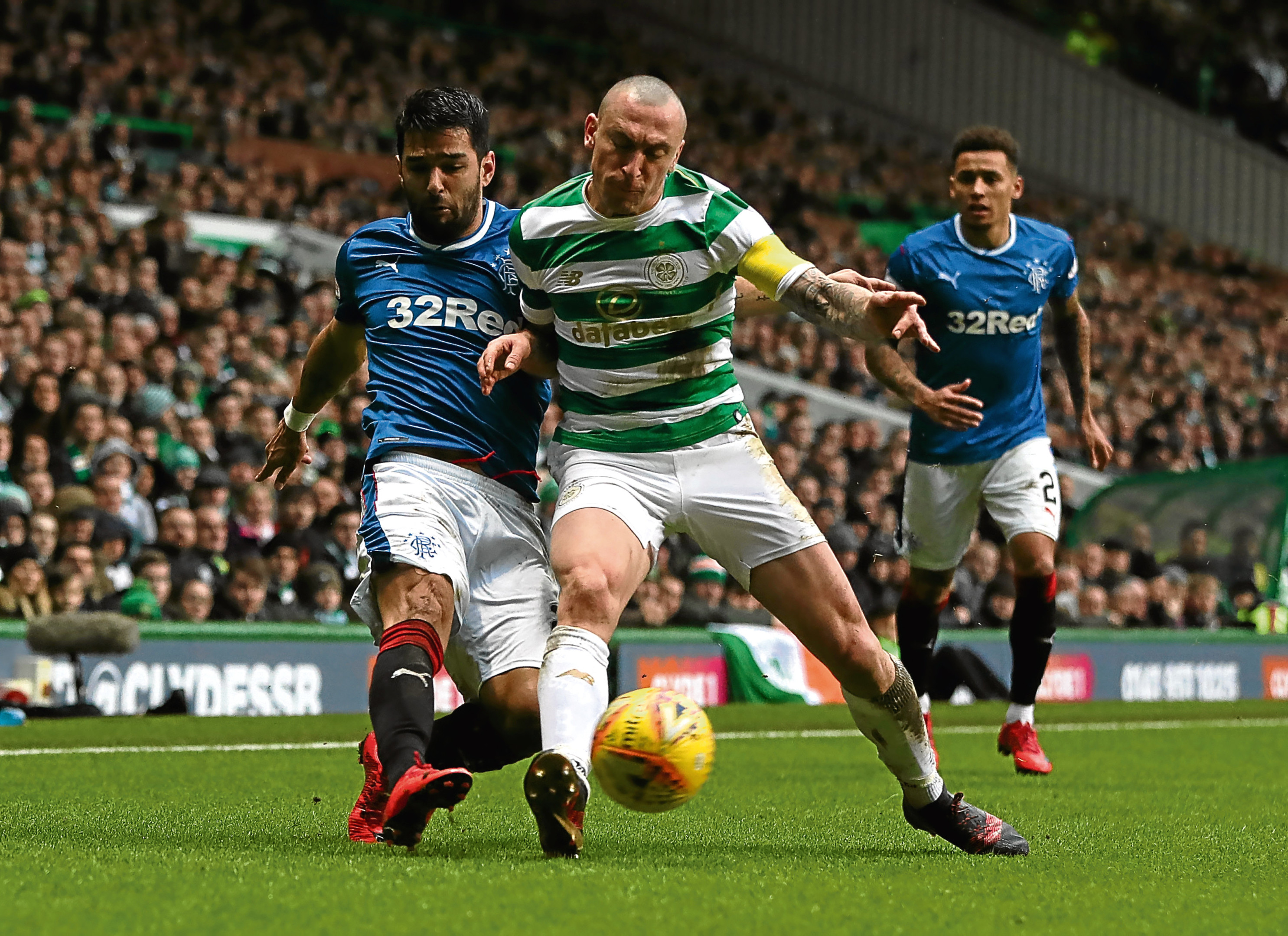 Scott Brown vies with Daniel Candeias in December's Old Firm clash (Ian MacNicol/Getty Images)