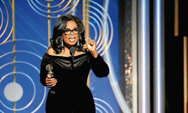 Oprah Winfrey accepts the 2018 Cecil B. DeMille Award during the 75th Annual Golden Globe Awards (Paul Drinkwater/NBCUniversal via Getty Images)