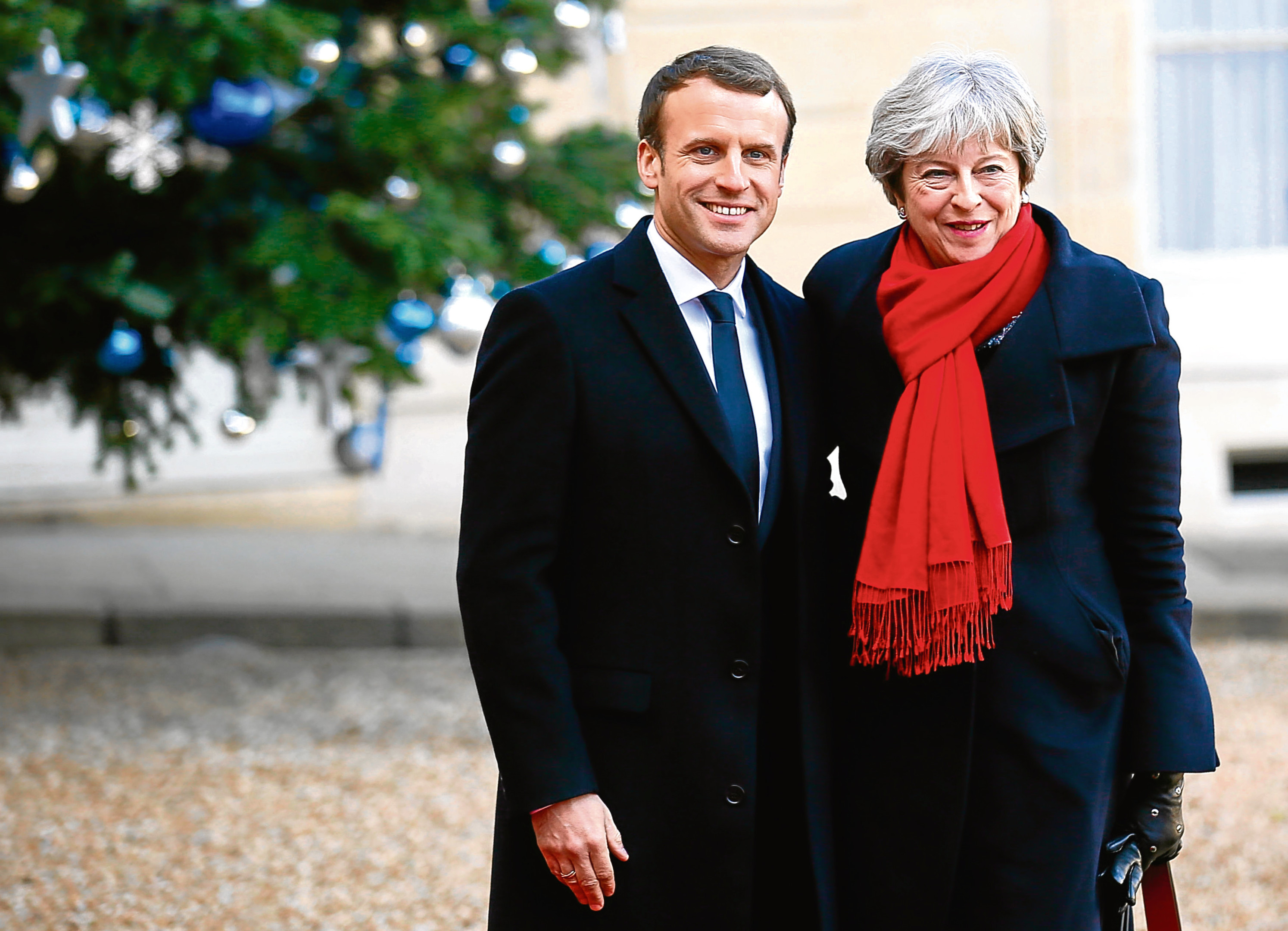 British Prime Minister Theresa May is welcomed by French President before a lunch at the Elysee Palace in Paris, Tuesday, Dec. 12, 2017. (AP Photo/Francois Mori)