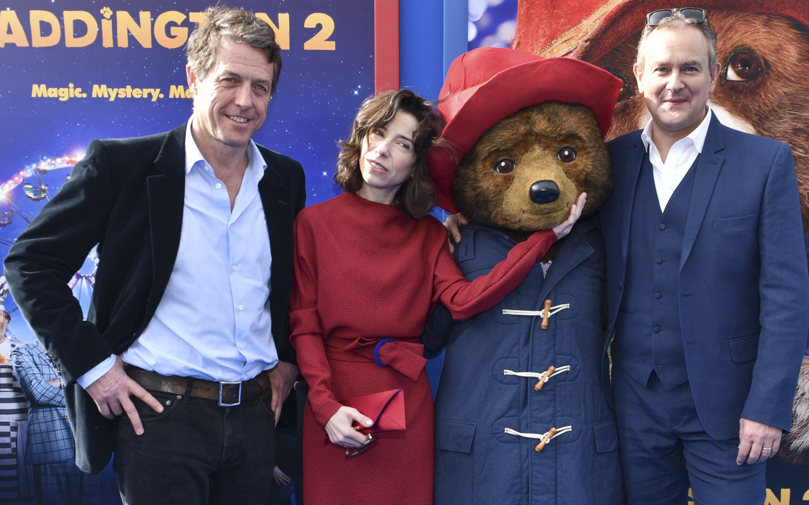 Actors Hugh Grant, Sally Hawkins, and Hugh Bonneville arrive at the premiere of Paddington 2 (Rodin Eckenroth/Getty Images)