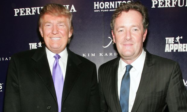 Donald Trump (L) and Piers Morgan, pictured in 2010 (John W. Ferguson/Getty Images)