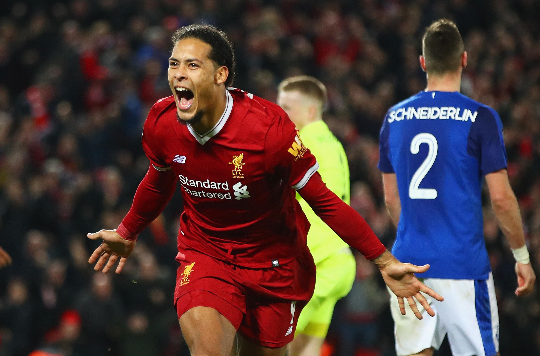 Virgil van Dijk celebrates scoring on his Liverpool debut (Clive Brunskill/Getty Images)