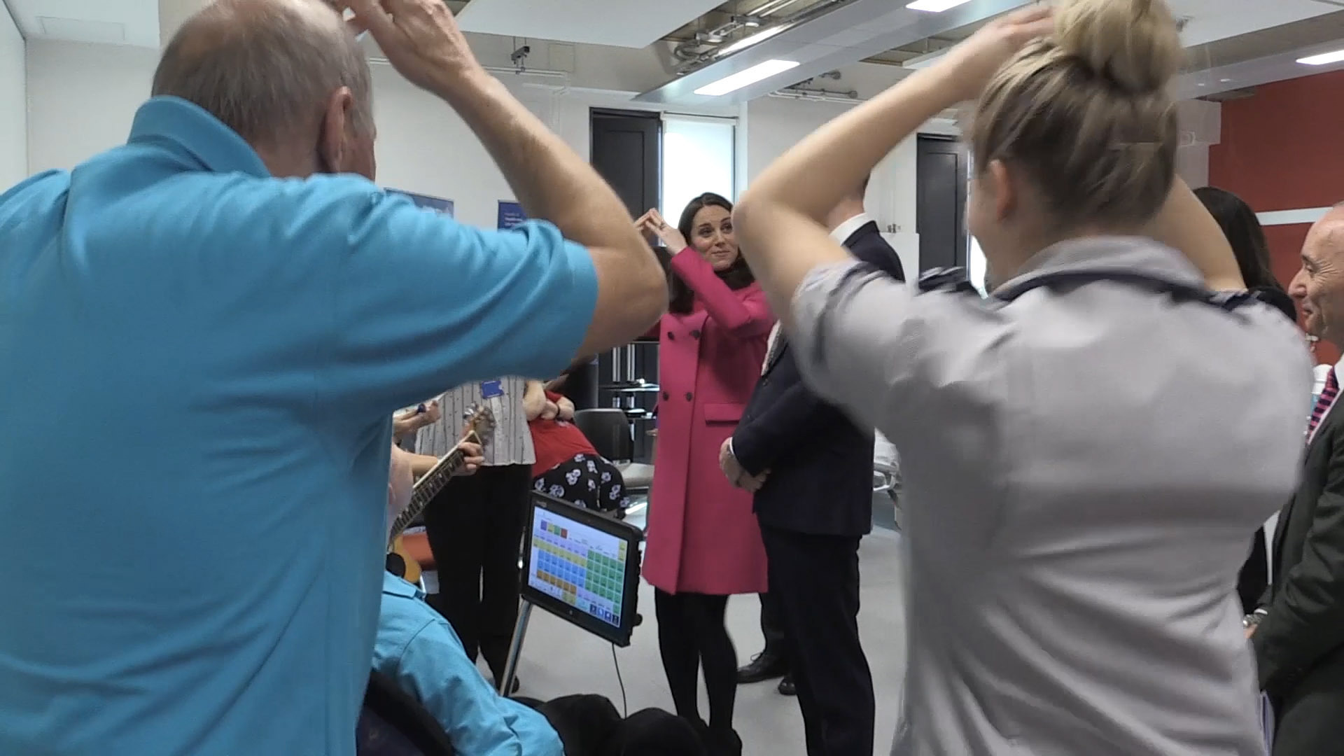 The Duke and Duchess of Cambridge 'wiggle' with staff as they tour the Science and Health Building at Coventry University (Phil Barnett/PA)