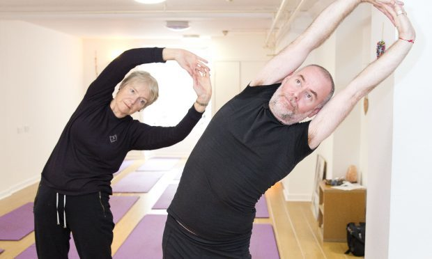 Yoga instructor Pol Mollan takes a class for the over 60s in his studio in Glasgow (Jamie Williamson)