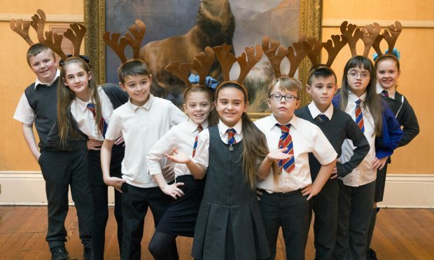 Kids from Arkleston Primary donned antler headbands for the opening of the Monarch of the Glen exhibition, in Paisley Museum (Jeff Holmes)