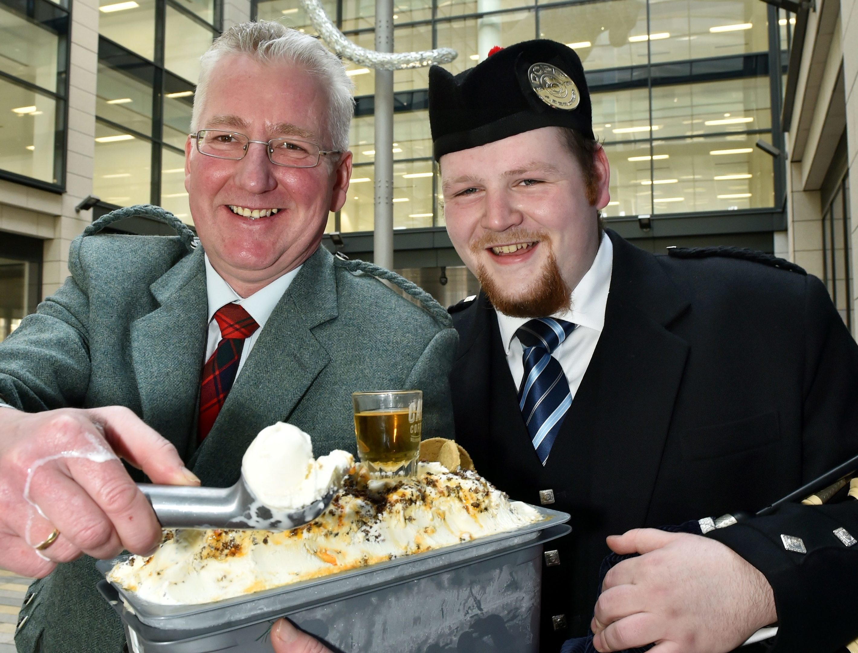 A 'Napoli' of Haggis Ice Cream was piped by Robert Reid, a member of the Deeside Caledona Pipe Band. The Haggis and Marmalade Ice Cream is tasted by Mackie's John Reid. (Colin Rennie)
