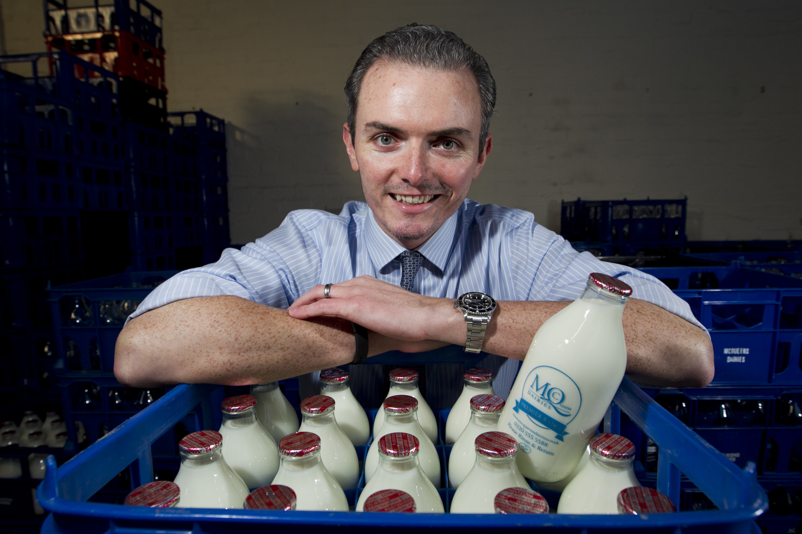 Callum McQueen, owner of McQueen's Dairy, which is seeing rising demand from people wanting glass milk bottles delivered to their door (Andrew Cawley / DC Thomson)