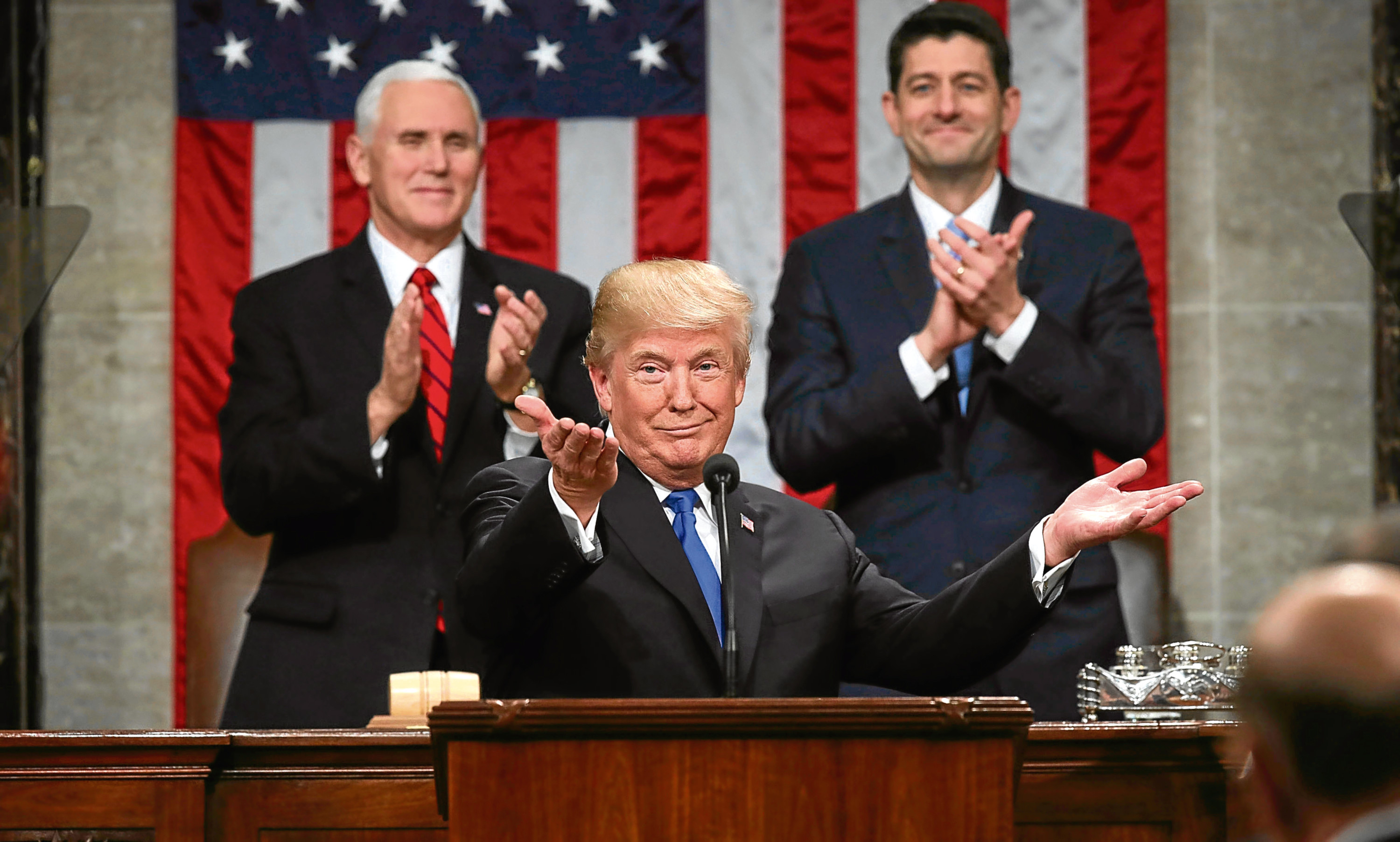 President Donald Trump gestures as delivers his first State of the Union address  (Win McNamee/Pool via AP)