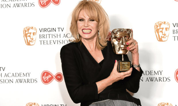 Joanna Lumley, winner of the Fellowship Award, poses in the Winner's room at the Virgin TV BAFTA Television Awards at The Royal Festival Hall on May 14, 2017 (Jeff Spicer/Getty Images)